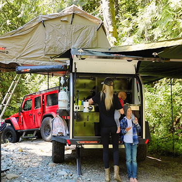 family with off road teardrop camper