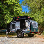 off road trailer by stream