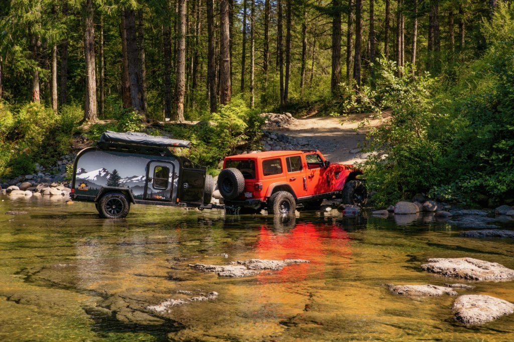 Off Grid Rebelles Jeep Wrangler Rubicon Crossing Water with Off Grid Trailer