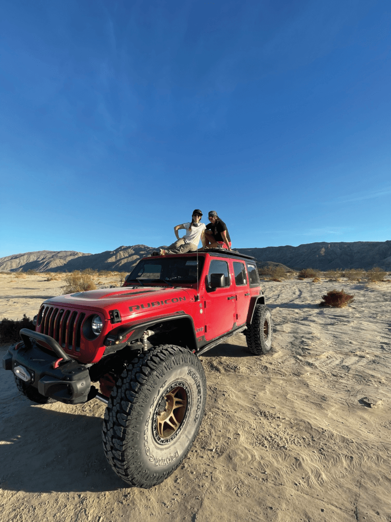 Off Grid Rebelles On top of the Jeep